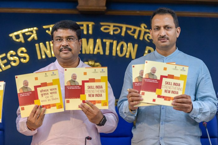 Union Minister for Petroleum, Natural Gas and Skill Development, Dharmendra Pradhan with MoS Anant Kumar Hegde (R) release booklets during a press conference on 48 months achievements and initiatives of his ministry under the NDA government rule, in New Delhi on Wednesday. PTI