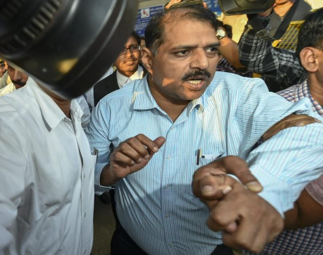 Deputy Superintendent of Police Devender Kumar after being produced at Patiala House Courts, in New Delhi, Tuesday, Oct 23, 2018. CBI arrested Devendra Kumar Monday in connection with bribery allegations involving its Special Director Rakesh Asthana. (PTI