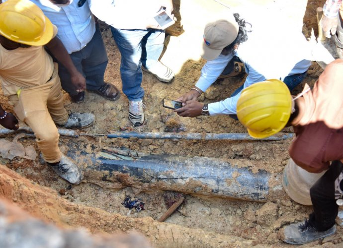 A team of GAIL officials inspects the damaged pipeline in Garudacharapalya on Whitefield Main Road on Monday.