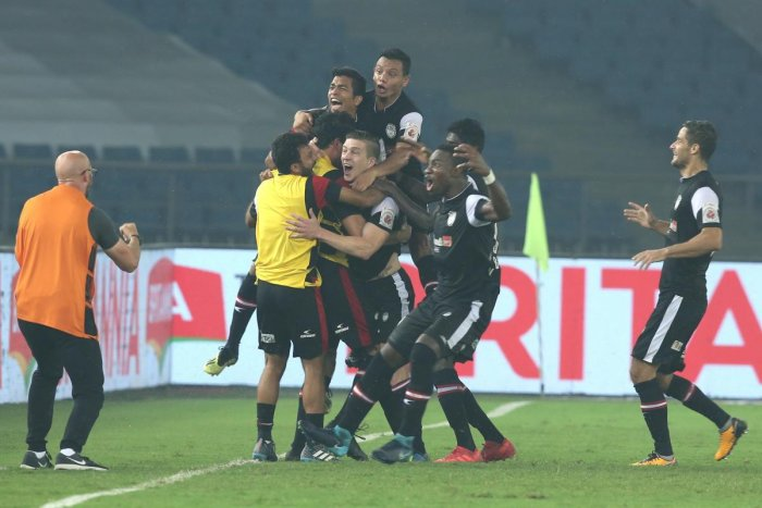JUBILANT: NEUFC players celebrate after their win over hosts Delhi Dynamos on Tuesday. ISL