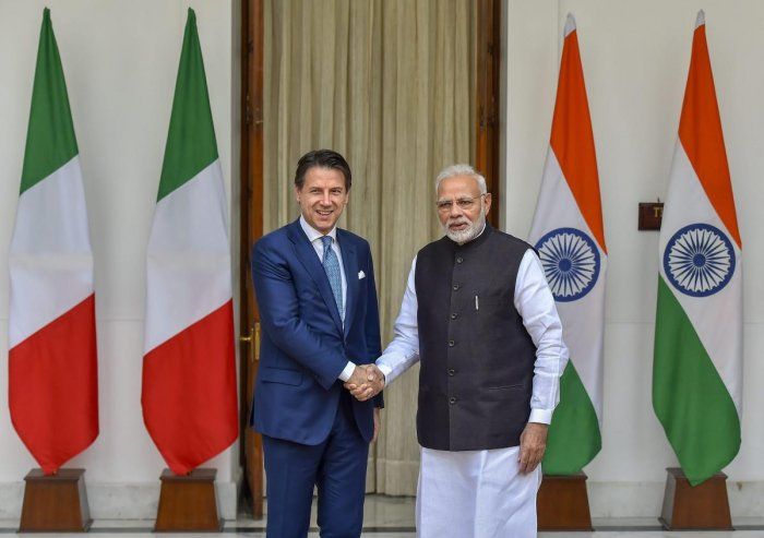 Prime Minister Narendra Modi shakes hands with Italian Prime Minister Giuseppe Conte before a meeting at Hyderabad House, in New Delhi on Tuesday. PTI