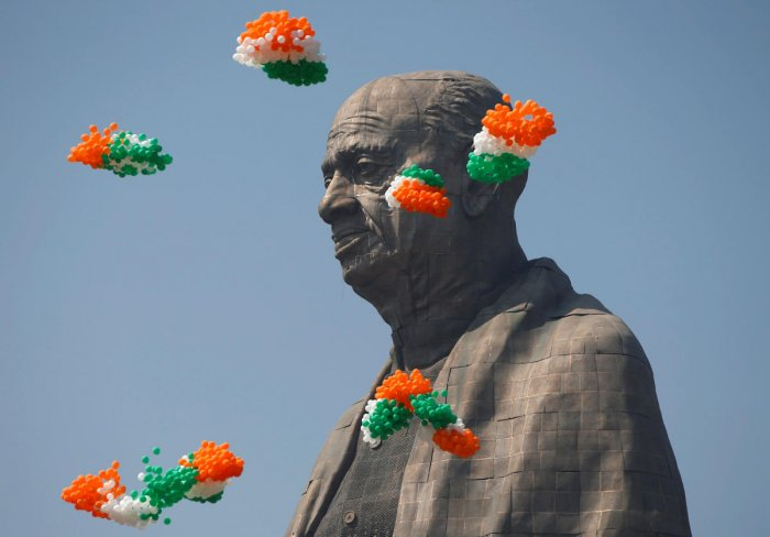 "Tri-coloured balloons fly around the ""Statue of Unity"" portraying Sardar Vallabhbhai Patel, one of the founding fathers of India, during its inauguration in Kevadia, in the western state of Gujarat, India, October 31, 2018. REUTERS"