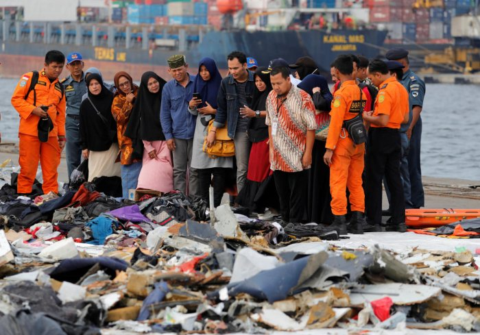 Families of passengers of Lion Air flight JT610 stand as they look at the belongings of the passengers at Tanjung Priok port in Jakarta, Indonesia, October 31, 2018. REUTERS