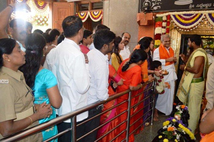 Dharmasthala Dharmadhikari Veerendra Heggade offer prayers at Hasanamba temple in Hassan, on Thursday.