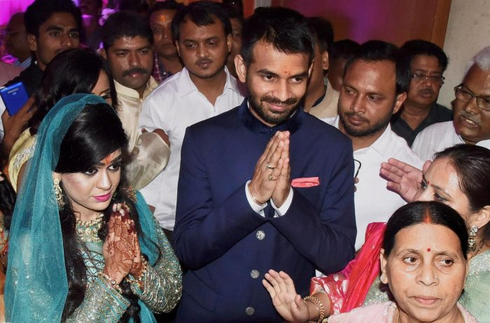 A file photo: Tej Pratap Yadav with fiancee Aishwarya Rai granddaughter of former Bihar chief minister Daroga Prasad Rai during their engagement function in Patna. (PTI file photo)