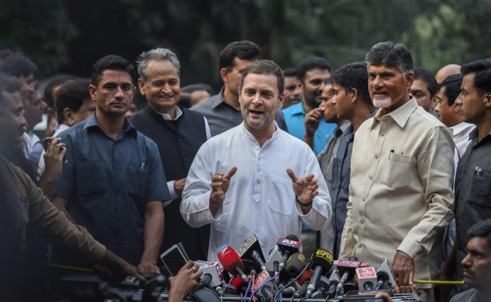 Congress President Rahul Gandhi along with Andhra Pradesh Chief Minister N Chandrababu Naidu addresses the media outside his residence at Tughlak Road in New Delhi on Thursday. PTI