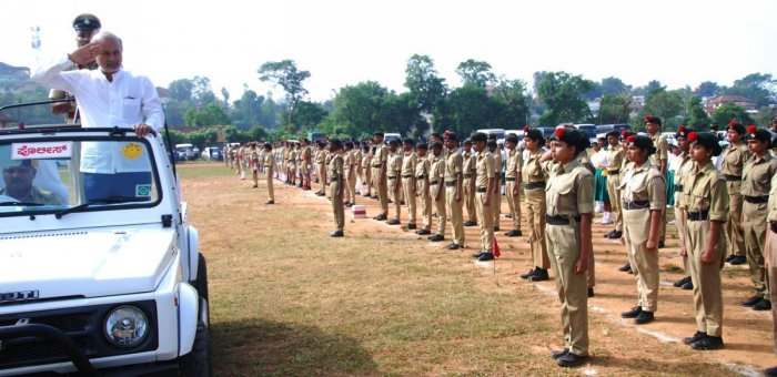 District In-charge Minister S R Ramesh receives guard of honour prior to the start of march past at General K S Thimmaiah Stadium in Madikeri on Thursday.