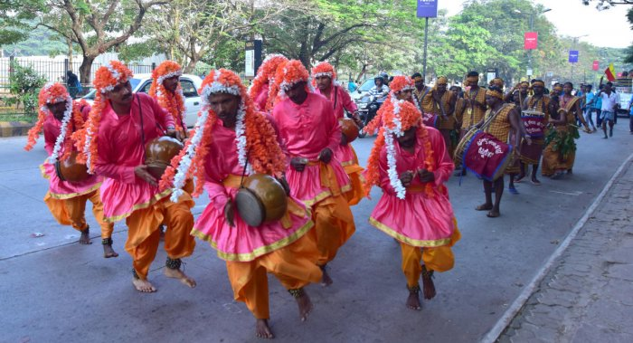 Members of Kudubi community perform 'Gumtas' during the procession organised prior to Rajyotsava celebrations at Nehru Maidan in Mangaluru on Thursday.
