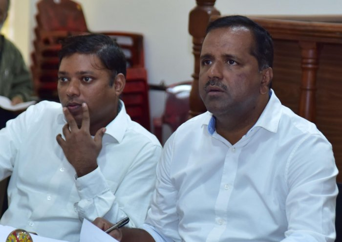 District In-charge Minister U T Khader at meeting at the DC Office in Mangaluru on Friday. Deputy Commissioner Sasikanth Senthil is also seen.