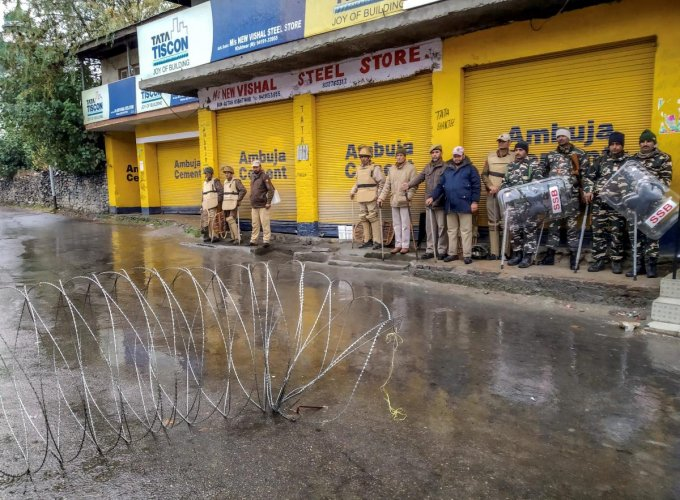 Security personnel stand guard during curfew after a senior BJP leader Anil Parihar (52) and his brother Ajeet (55), were killed by suspected militants on Thursday night, in Kishtwar, Jammu, Friday, Nov 02, 2018. (PTI Photo)