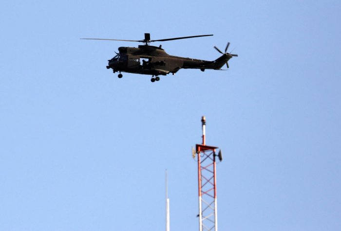 A NATO helicopter flies over the Resolute Support headquarters in Kabul, Afghanistan. Reuters Photo