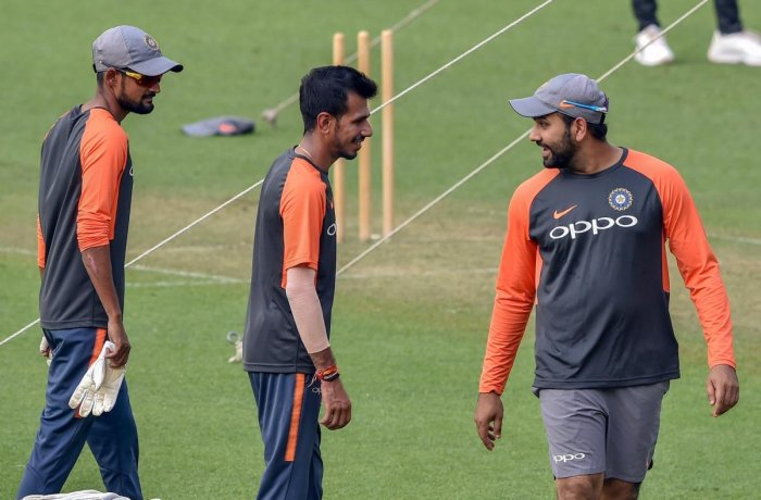 Rohit Sharma (right) with Yuzvendra Chahal at a training session ahead of the 1st T20 match against West Indies at the Eden Gardens in Kolkata. PTI