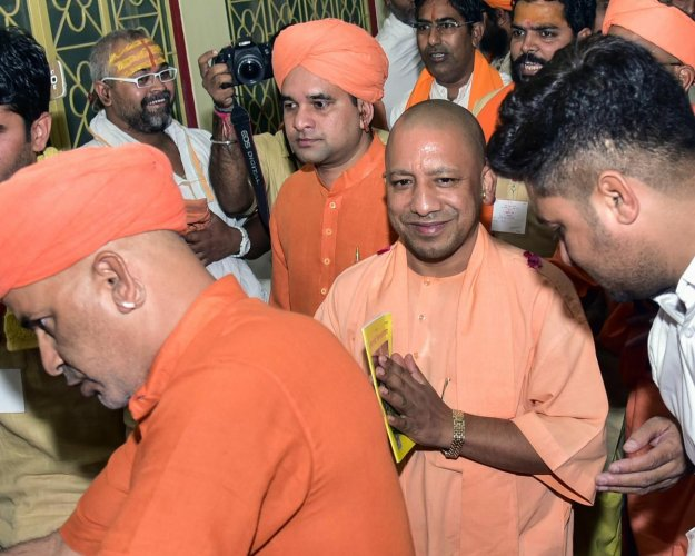 Under pressure from the saint community on the issue of Ram Temple construction through a Parliamentary legislation, Uttar Pradesh chief minister Yogi Adityanath on Tuesday renamed Faizabad district as Ayodhya while announcing an airport after Lord Rama a