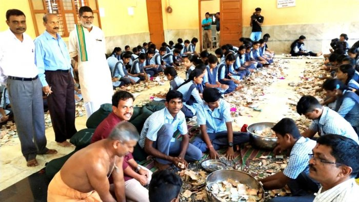 Students of Sri Mookambika educational institutions count the money.