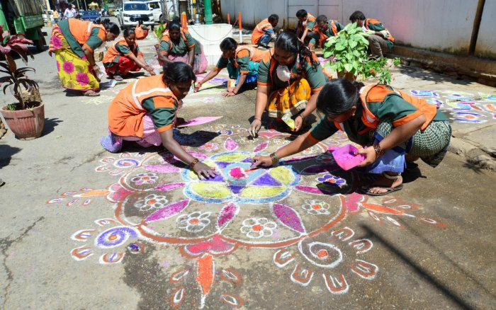 Black spots that were cleared of garbage and beautified by pourakarmikas with rangolis were found to be littered again. DH Photo