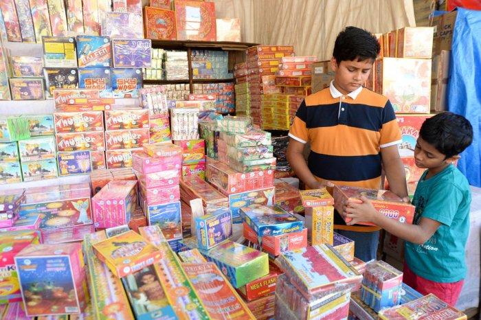 Boys shop for firecrackers in Malleswaram on Monday. DH PHOTO/SATISH BADIGER