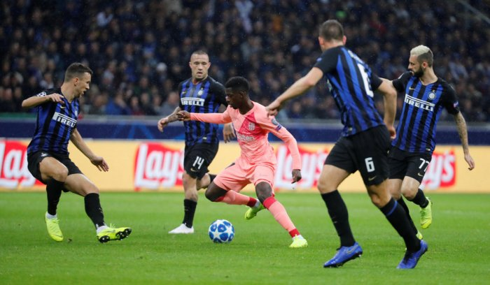 Barcelona's Ousmane Dembele in action with Inter Milan's Ivan Perisic, Radja Nainggolan and Marcelo Brozovic during the UEFA Champions League group stage match at the San Siro. (REUTERS)