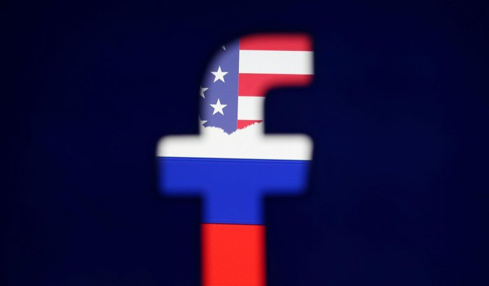 Photo illustration of a 3D printed Facebook logo in front of a displayed Russian flag. Reuters file photo