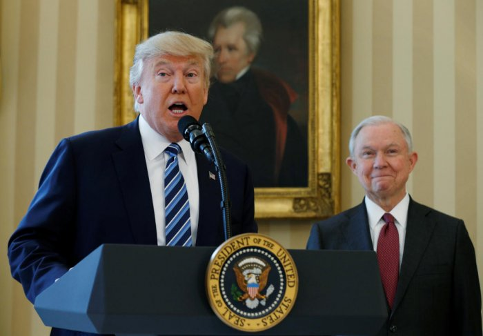 U.S. President Donald Trump speaks during a swearing-in ceremony for new Attorney General Jeff Sessions (R) at the White House in Washington, U.S., February 9, 2017. Reuters