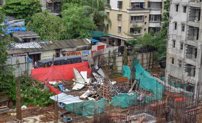 The debris of the chartered plane that crashed in Ghatkopar's Jivdaya Lane, in Mumbai on Friday. PTI
