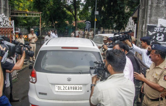 Activist Narendra Dabholkar's alleged shooter Sachin Prakasrao Andure being brought to Pune Sessions Court, in Pune on Sunday. PTI photo