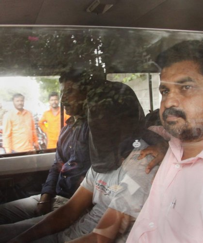 In this undated file photo, Sharad Kalaskar accussed in rationalist Narendra Dabholkar's murder is taken to Pune court. PTI