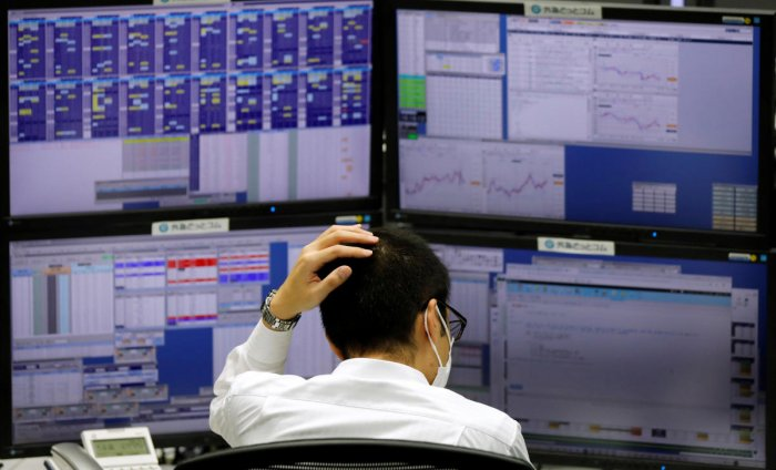 n employee of a foreign exchange trading company works in front of monitors in Tokyo. Reuters photo