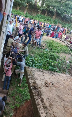 Two labourers were rescued after soil caved-in at a construction site in Madikeri on Tuesday.