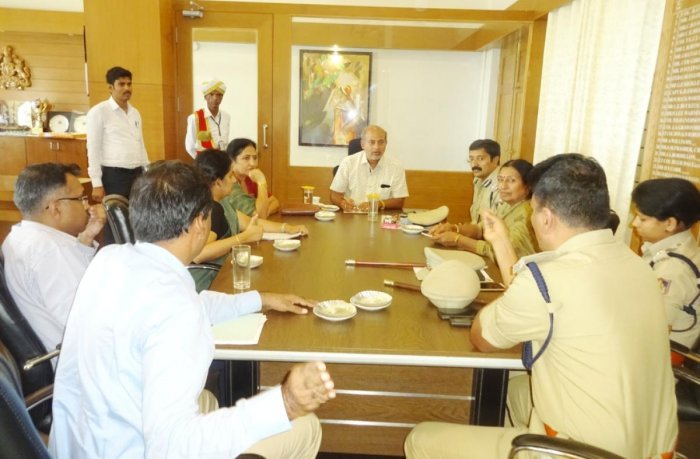 District In-charge Minister Sa Ra Mahesh chairs a meeting in Madikeri on Wednesday.