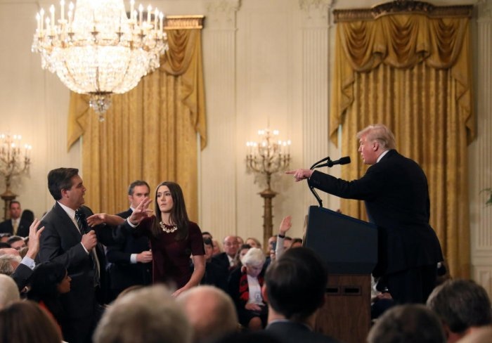 A White House staff member reaches for the microphone held by CNN's Jim Acosta as he questions U.S. President Donald Trump during a news conference in Washington. Reuters photo