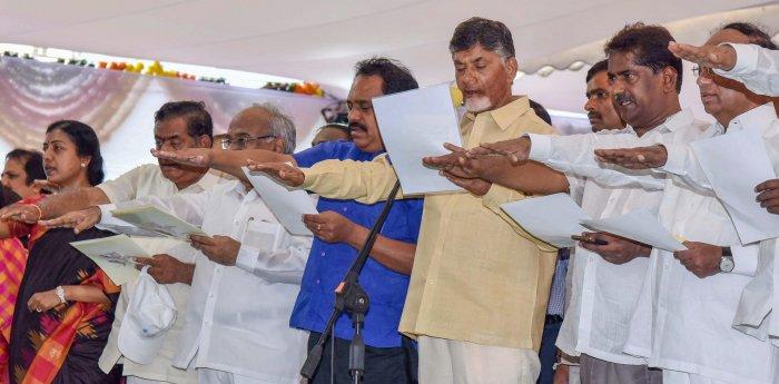 Andhra Pradesh Chief Minister N Chandrababu Naidu administers oath to the people during a 'Nava Nirmana Deeksha' programme, in Vijayawada on Saturday. PTI