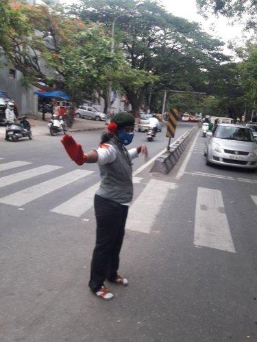 Geetha Lakshmi managing traffic on 13th main road junction in Indiranagar on Friday.