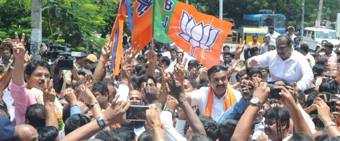 Padmanabhanagar BJP candidate R Ashoka, Basavanagudi BJP candidate Ravi Subramanya and Bommanahalli BJP candidate Satish Reddy celebrating their victory with his supporters infront of the SSMRV counting center in Bengaluru on Tuesday. Photo Srikanta Sharm