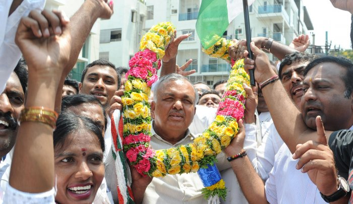 BTM layout congress candidate Ramalinga Reddy comming out of the counting center with his supporters after winning the MLA election at SSMRV counting center in Bengaluru on Tuesday. Photo Srikanta Sharma R.