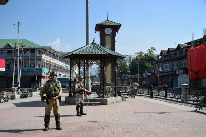 Security personnel guard during the strike call given by separatist leaders against urban local bodies elections, at Lal Chowk in Srinagar. (PTI Photo/S Irfan)