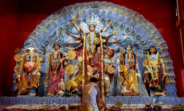 "A priest offers Maha Ashtami ""Sandhi Puja"" at a Puja pandal during the ongoing Durga Puja festival, in Kolkata. PTI file photo"