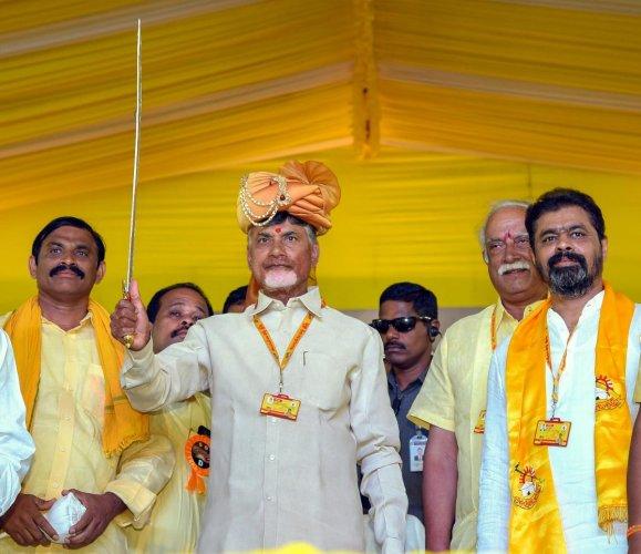 Andhra Pradesh Chief Minister Chandrababu Naidu holds a sword during 'Dharma Porata Deeksha' being held at Produturu, in Kadapa, on Tuesday. PTI