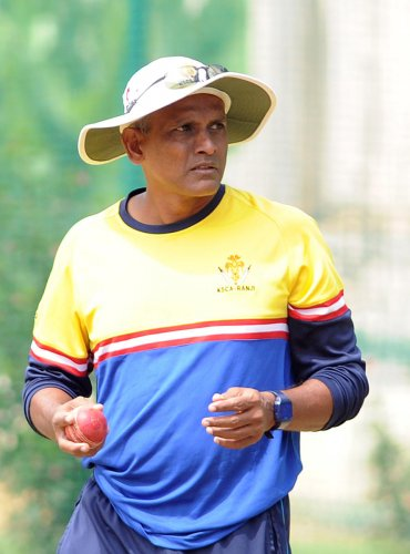 ALL IS WELL: Karnataka coach Yere Goud is hoping young guns will step up to the plate and deliver in the absence of senior players. DH Photo/ Srikanta Sharma R