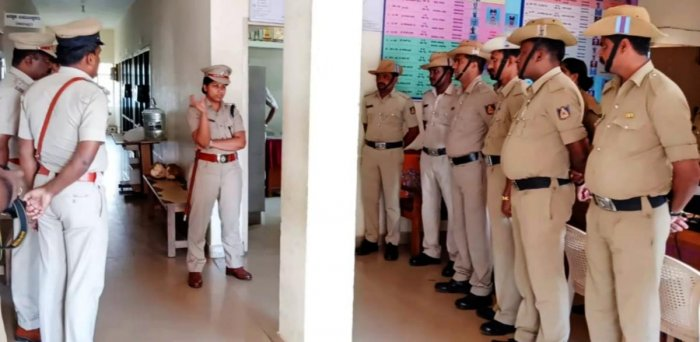 Superintendent of Police Suman D Pannekar speaks to the police personnel, at Somvarpet police station on Thursday, on security measures for Tipu Jayanti.