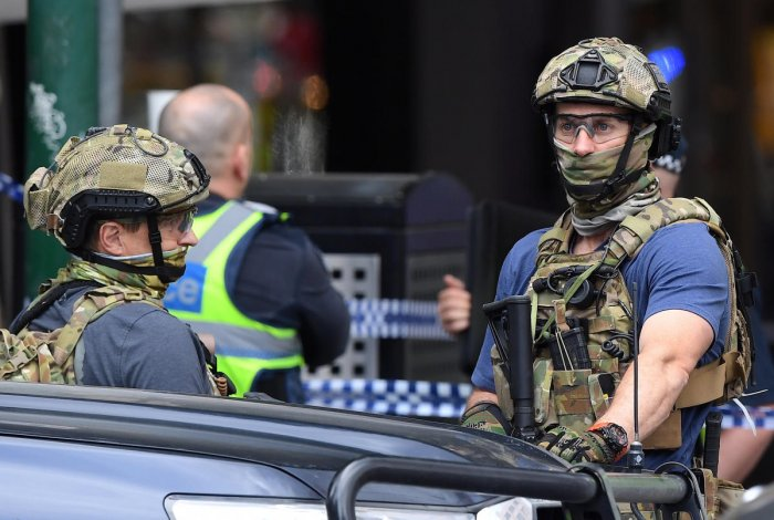 Armed security personnel stand near the Bourke Street mall in central Melbourne. Reuters Photo