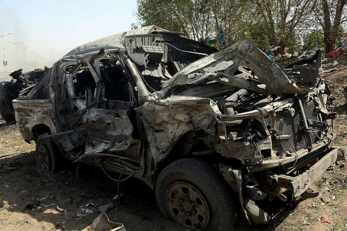 The wreckage of a car reportedly destroyed in an air strike in the downtown area of Hodeida. (AFP Photo)