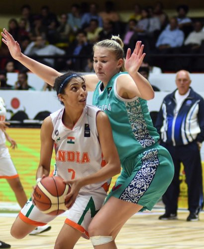 Swift rise Harshitha Bopaiah (left) in action in the Division B final of the FIBA U-18 Women's Asian Basketball championship. DH Photo/ Srikanta Sharma R