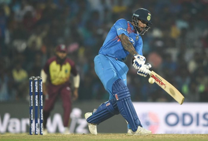 Indian cricketer Shikhar Dhawan plays a shot during the 3rd and final T20 match against West Indies in Chennai, Sunday, Nov. 11, 2018. (PTI Photo)