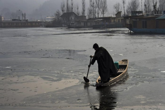 A man rows his boat on the partially frozen Dal Lake in Srinagar. PTI file photo