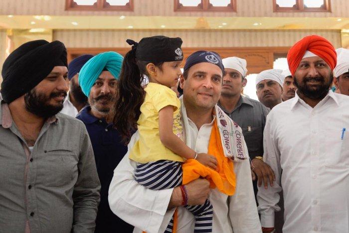 Congress president Rahul Gandhi arrives to pay obeisance at Gurudwara Singh Sabha, in Rajnandgaon, on Saturday/. PTI