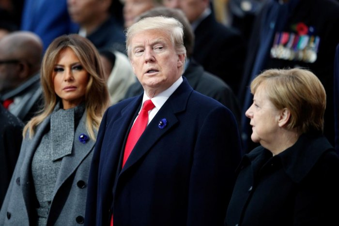 President Donald Trump (C), his wife Melania Trump (L) and German Chancellor Angela Merkel (R) look on as they attend a ceremony at the Arc de Triomphe in Paris. AFP photo