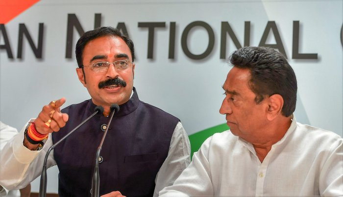Sanjay Singh, brother-in-law of Madhya Pradesh Chief Minister Shivraj Singh Chouhan addresses the press along with senior Congress leaders Kamal nath after joining the Congress party, at AICC in New Delhi on Saturday. PTI