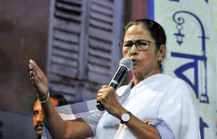 West Bengal Chief Minister Mamata Banerjee addresses the gathering during the inauguration of Goddess Kali Puja, ahead Kali Puja festival, in Kolkata on Friday. PTI