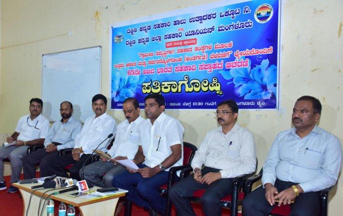 DK district Cooperative Union President Harish Acharya speaks to reporters at Dakshina Kannada Milk Union Ltd Dairy at Kulshekhar in Mangaluru on Monday. DKMUL president K Raviraj Hegde, DKMUL Director Kaup Diwakar Shetty, Managing Director B V Satyanaray