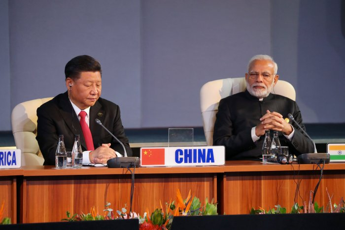 Indian Prime Minister Narendra Modi and China's President Xi Jinping attend the BRICS summit meeting in Johannesburg, South Africa, July 27, 2018. Credit: Reuters/Mike Hutchings